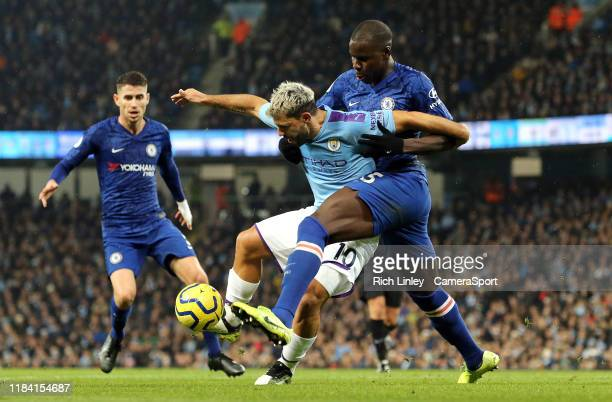 Manchester City's Sergio Aguero shields the ball from Chelsea's Kurt Zouma during the Premier League match between Manchester City and Chelsea FC at...