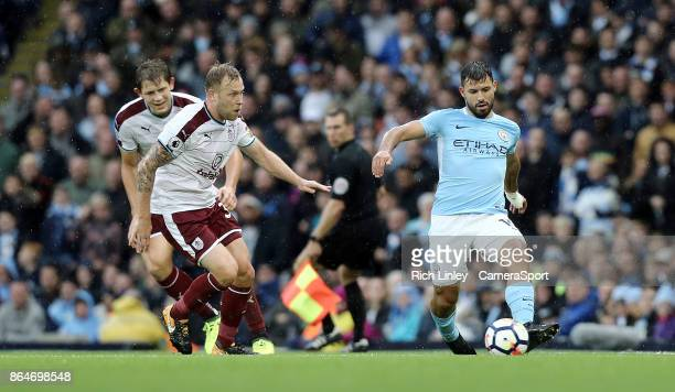 Manchester City's Sergio Aguero under pressure from Burnley's Scott Arfield during the Premier League match between Manchester City and Burnley at...