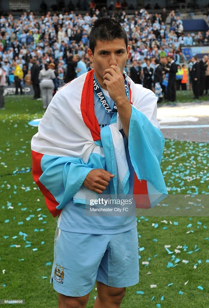 Manchester City's Sergio Aguero with his winners medall.
