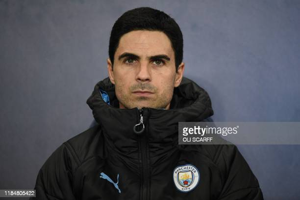 Manchester City's Spanish assistant manager Mikel Arteta takes his seat for the UEFA Champions League football Group C match between Manchester City...