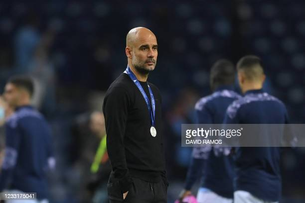 Manchester City's Spanish coach Josep Guardiola reacts at the end of the UEFA Champions League final football match between Manchester City and...