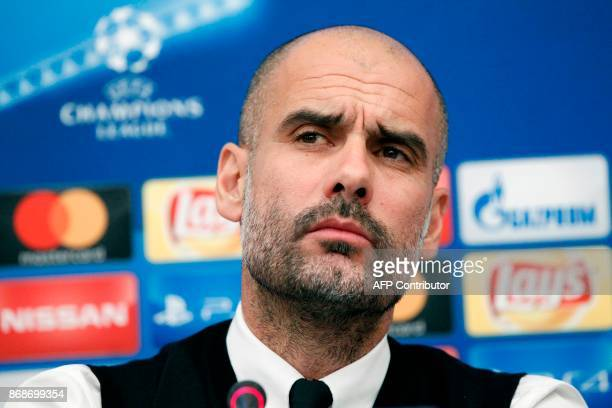 Manchester City's Spanish coach Pep Guardiola attends a press conference on the eve of the UEFA Champions League football match Napoli vs Manchester...