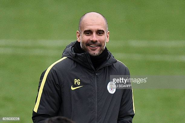 Manchester City's Spanish coach Pep Guardiola attends a training session at the City Football Academy in Manchester northern England on November 22...