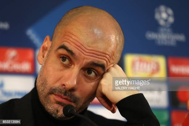 Manchester City's Spanish coach Pep Guardiola looks on during a press conference in Monaco on March 14 on the eve of their UEFA Champions League...