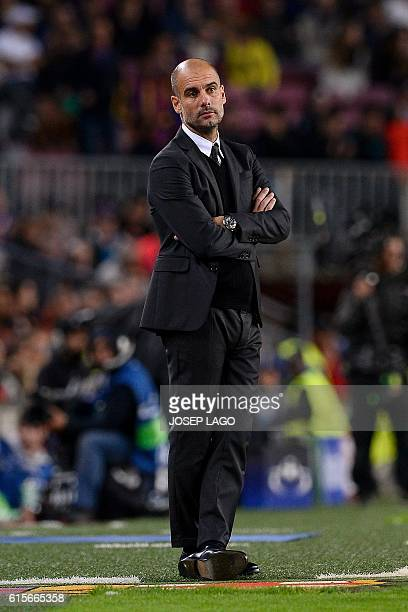 Manchester City's Spanish coach Pep Guardiola looks on during the UEFA Champions League football match FC Barcelona vs Manchester City at the Camp...