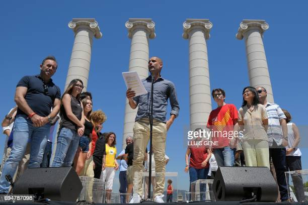Manchester City's Spanish coach Pep Guardiola speaks during a demonstration dubbed 'Referendum is Democracy' organized by ANC AMI and Omnium Cultural...