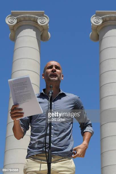 Manchester City's Spanish coach Pep Guardiola speaks during a demonstration named 'Referendum is Democracy' organized by ANC AMI and Omnium Cultural...