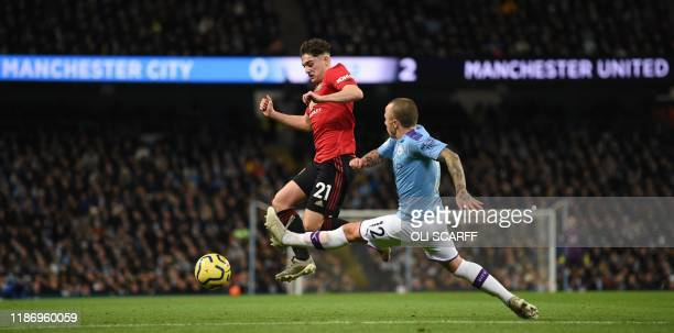 Manchester City's Spanish defender Angelino challenges Manchester United's Welsh midfielder Daniel James during the English Premier League football...