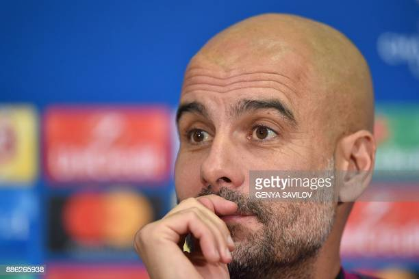 Manchester City's Spanish head coach Pep Guardiola addresses a press conference in Kharkiv on December 5 on the eve of the UEFA Champion League Group...