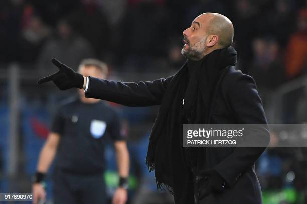 Manchester City's Spanish head coach Pep Guardiola gestures during the UEFA Champions League round of 16 first leg football match between Basel and...