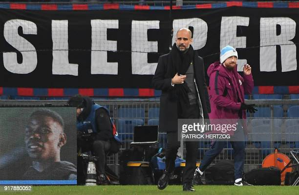 Manchester City's Spanish head coach Pep Guardiola looks on before the UEFA Champions League round of 16 first leg football match between Basel and...