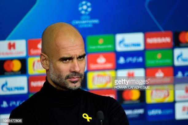Manchester City's Spanish head coach Pep Guardiola looks on during a press conference at the Groupama stadium in Decines-Charpieu, central-eastern...