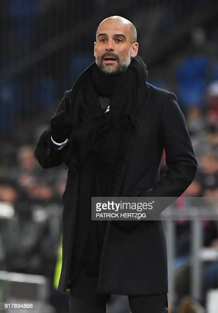 Manchester City's Spanish head coach Pep Guardiola reacts during the UEFA Champions League round of 16 first leg football match between Basel and...
