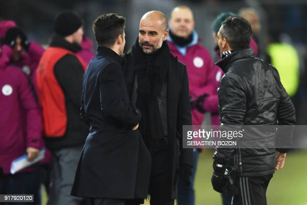 Manchester City's Spanish head coach Pep Guardiola speaks with Basel's Swiss head coach Raphael Wicky after the UEFA Champions League round of 16...