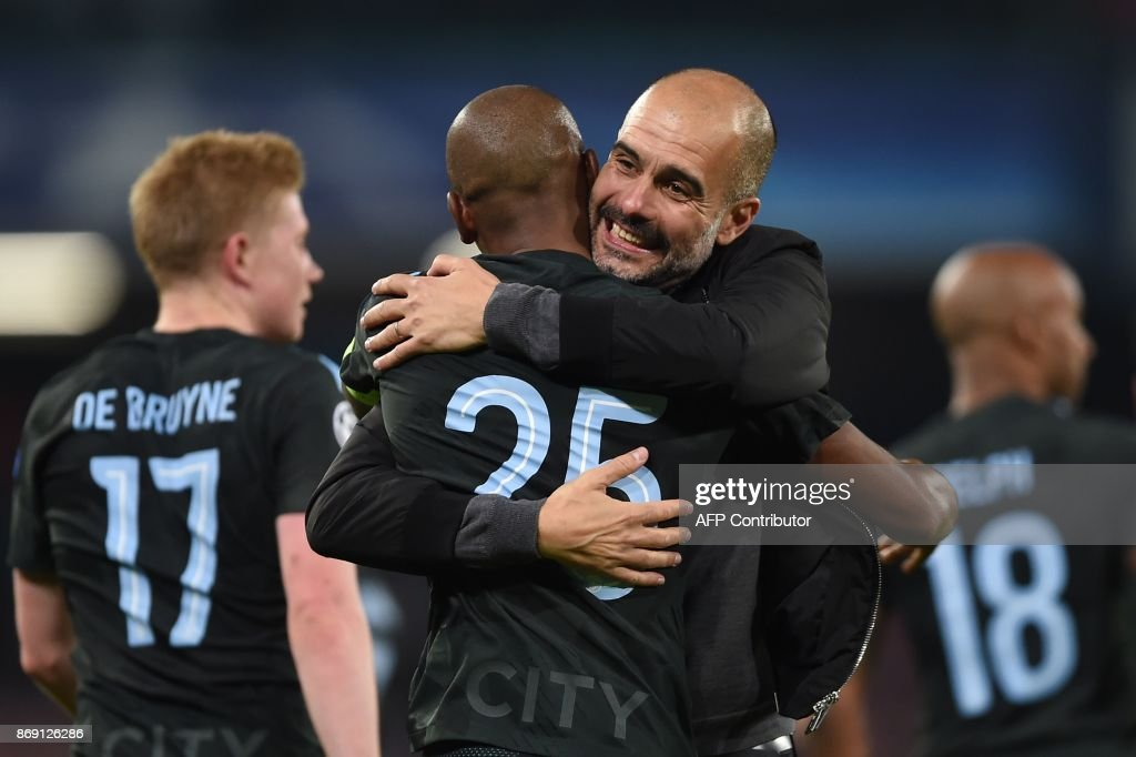 Manchester City's Spanish headcoach Pep Guardiola hugs Manchester City's Brazilian midfielder Fernandinho at the end of the UEFA Champions League football match Napoli vs Manchester City on November 1, 2017 at the San Paolo stadium in Naples. Manchester City won 2-4. / AFP PHOTO / Filippo MONTEFORTE
