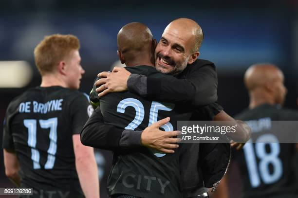Manchester City's Spanish headcoach Pep Guardiola hugs Manchester City's Brazilian midfielder Fernandinho at the end of the UEFA Champions League...