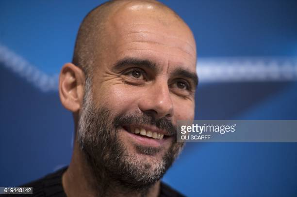 Manchester City's Spanish manager Pep Guardiola addresses the media during a press conference at the City Football Academy in Manchester northern...