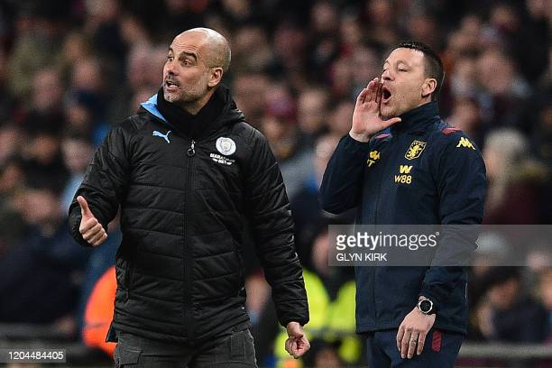 Manchester City's Spanish manager Pep Guardiola and Aston Villa's English assistant manager John Terry shout to their players during the English...