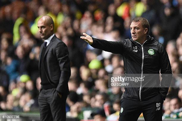 Manchester City's Spanish manager Pep Guardiola and Celtic's Northern Irish manager Brendan Rodgers watches his players from the touchline during the...