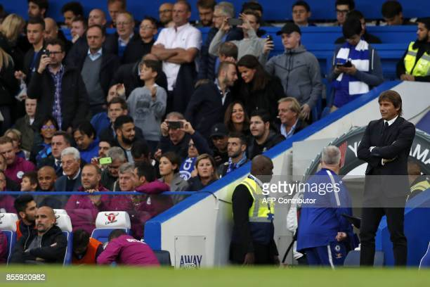 Manchester City's Spanish manager Pep Guardiola and Chelsea's Italian head coach Antonio Conte await kick off in the English Premier League football...