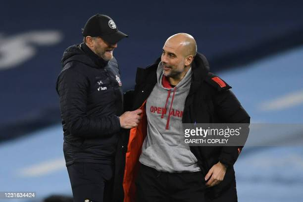 Manchester City's Spanish manager Pep Guardiola and Southampton's Austrian manager Ralph Hasenhuttl chat at the final whistle during the English...
