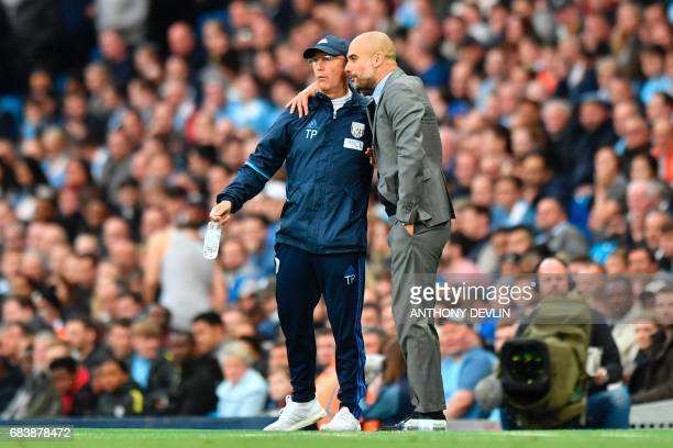 Manchester City's Spanish manager Pep Guardiola and West Bromwich Albion's Welsh head coach Tony Pulis exchange words on the touchline during the...
