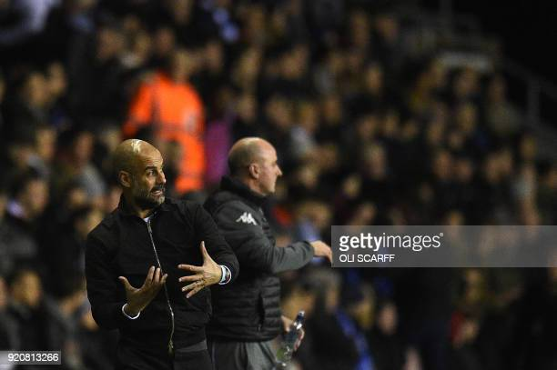 Manchester City's Spanish manager Pep Guardiola and Wigan Athletic's English Manager Paul Cook gesture during the English FA Cup fifth round football...