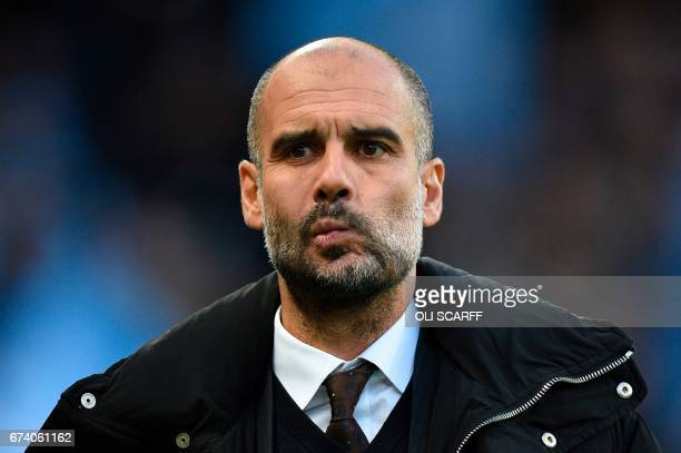 Manchester City's Spanish manager Pep Guardiola arrives for the English Premier League football match between Manchester City and Manchester United...