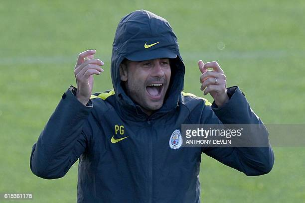 Manchester City's Spanish manager Pep Guardiola attends a team training session at Manchester City Football Academy Campus in Manchester north west...