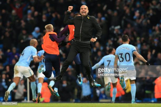 Manchester City's Spanish manager Pep Guardiola celebrates after Manchester City's English midfielder Raheem Sterling scores his team's second goal...