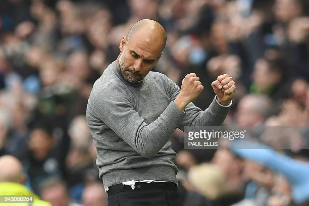 Manchester City's Spanish manager Pep Guardiola celebrates Manchester City's German midfielder Ilkay Gundogan scored the second goal during the...