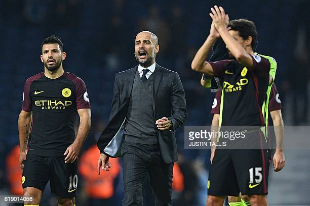 Manchester City's Spanish manager Pep Guardiola celebrates on the pitch with his players after the English Premier League football match between West...