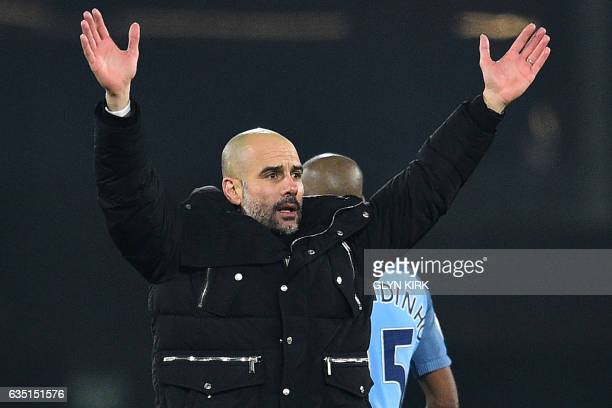 Manchester City's Spanish manager Pep Guardiola celebrates on the pitch after the English Premier League football match between Bournemouth and...