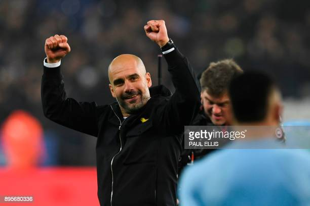 Manchester City's Spanish manager Pep Guardiola celebrates on the pitch after winning after the penalty shoot out in the English League Cup...