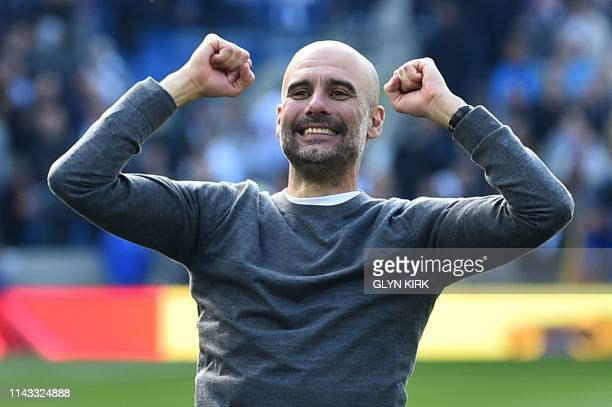 Manchester City's Spanish manager Pep Guardiola celebrates winning the Premier League title after their 41 victory in the English Premier League...