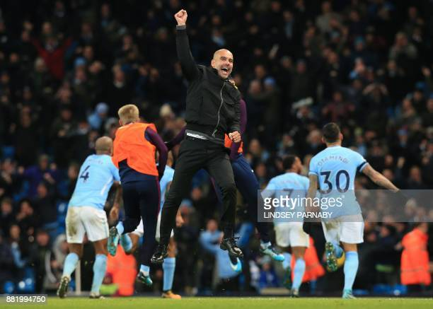 TOPSHOT Manchester City's Spanish manager Pep Guardiola celebrsates after Manchester City's English midfielder Raheem Sterling scores his team's...
