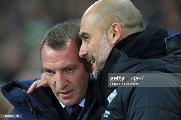 Manchester City's Spanish manager Pep Guardiola chats with Leicester City's Northern Irish manager Brendan Rodgers before the English Premier League...