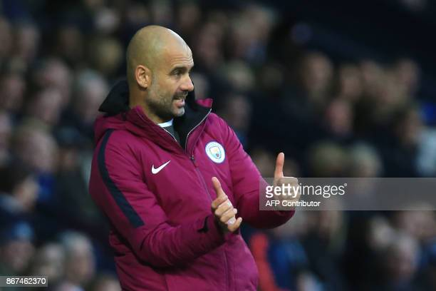 Manchester City's Spanish manager Pep Guardiola during the English Premier League fogestures otball match between West Bromwich Albion and Manchester...