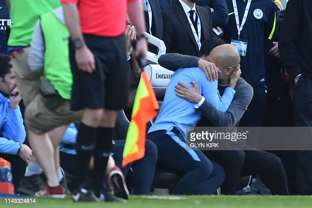 Manchester City's Spanish manager Pep Guardiola embraces his assistant Mikel Arteta at the final whistle of the English Premier League football match...