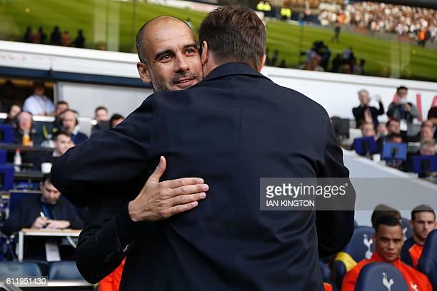 Manchester City's Spanish manager Pep Guardiola embraces Tottenham Hotspur's Argentinian head coach Mauricio Pochettino ahead of the English Premier...