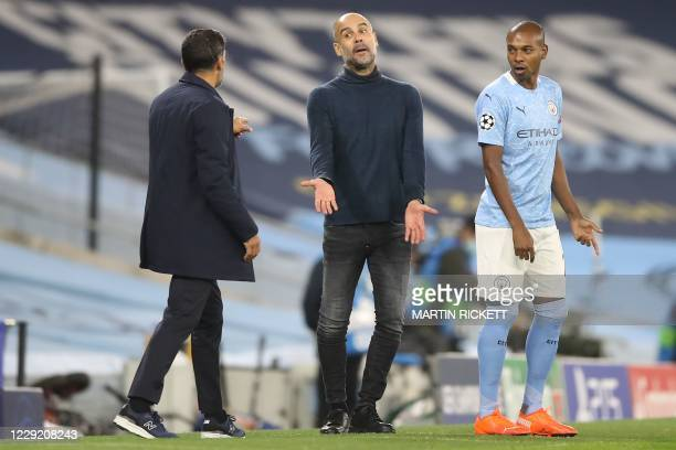 Manchester City's Spanish manager Pep Guardiola gestures as he exchanges words with Porto's Portuguese coach Sergio Conceicao during the UEFA...