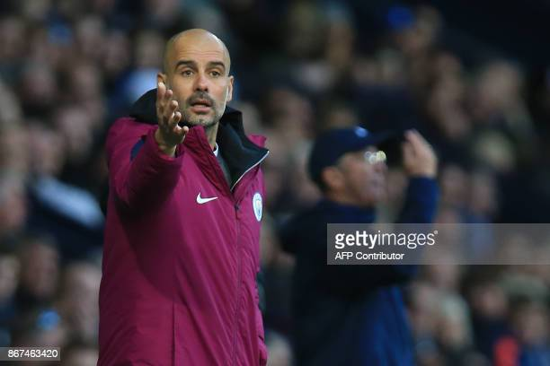 Manchester City's Spanish manager Pep Guardiola gestures as West Bromwich Albion's Welsh head coach Tony Pulis looks on during the English Premier...