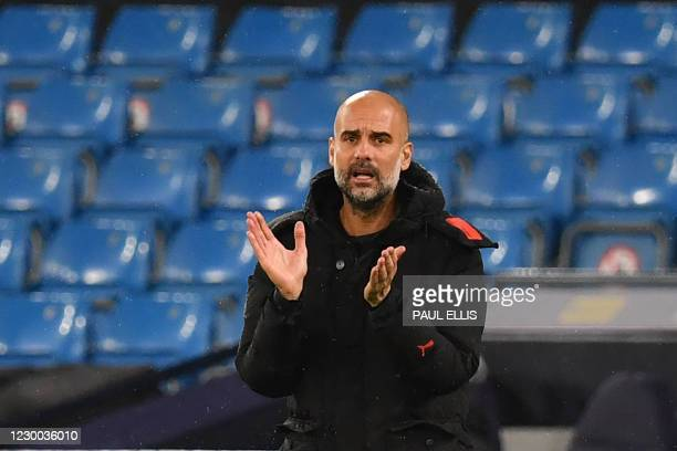 Manchester City's Spanish manager Pep Guardiola gestures during the UEFA Champions League 1st round day 6 group C football match between Manchester...