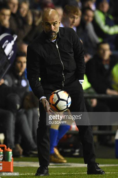 Manchester City's Spanish manager Pep Guardiola gestures during the English FA Cup fifth round football match between Wigan Athletic and Manchester...