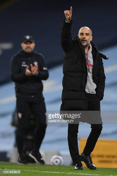 Manchester City's Spanish manager Pep Guardiola gestures from the side-lines as Southampton's Austrian manager Ralph Hasenhuttl looks on during the...