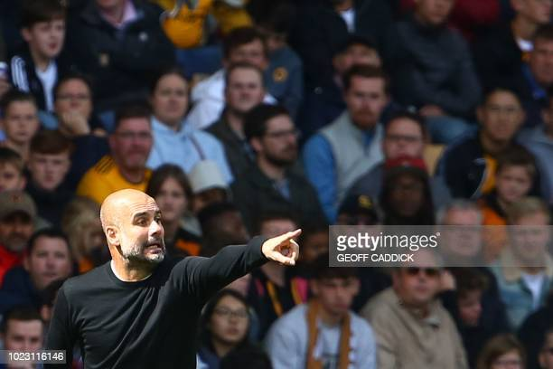 Manchester City's Spanish manager Pep Guardiola gestures from the touchline during the English Premier League football match between Wolverhampton...