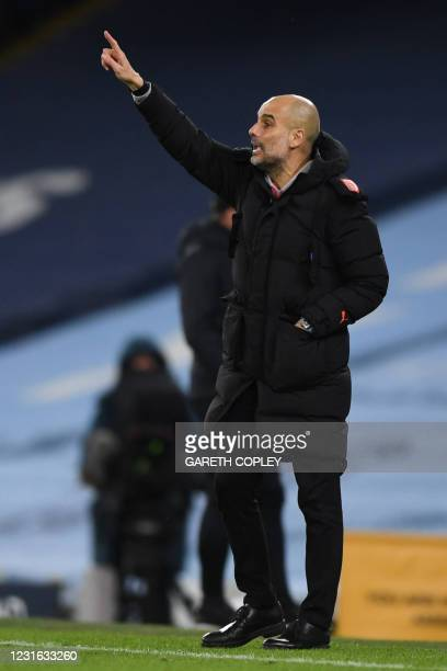 Manchester City's Spanish manager Pep Guardiola gestures from the side-lines during the English Premier League football match between Manchester City...