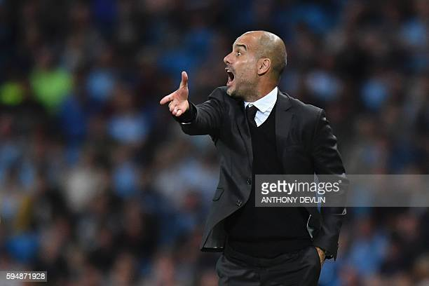 Manchester City's Spanish manager Pep Guardiola gestures from the touchlien during the UEFA Champions league second leg playoff football match...