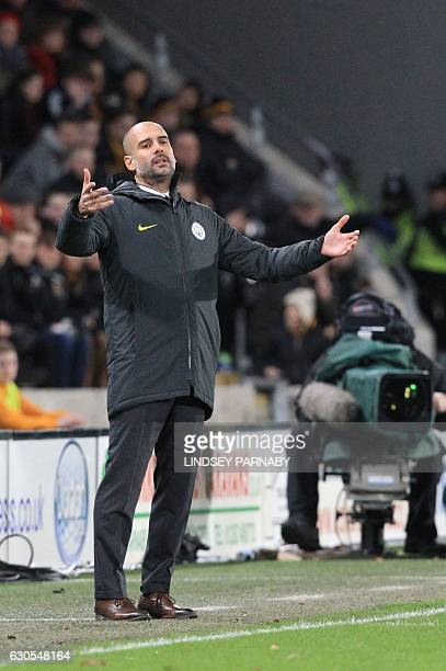 Manchester City's Spanish manager Pep Guardiola gestures from the touchline during the English Premier League football match between Hull City and...