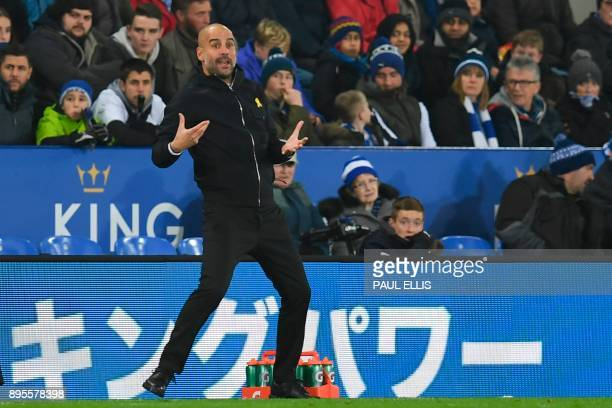 Manchester City's Spanish manager Pep Guardiola gestures on the touchline during the English League Cup quarterfinal football match between Leicester...